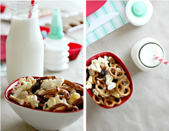 trail mix and milk set up for kids to enjoy while decorating cookies
