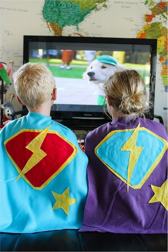 A boy and girl wearing handmade fleece no-sew super hero capes
