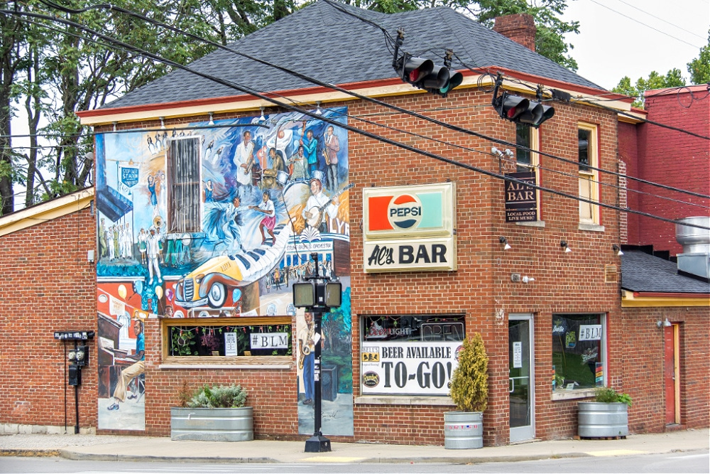 A tradition of music mural by Michael Burrell on the wall of Al's Bar in Lexington