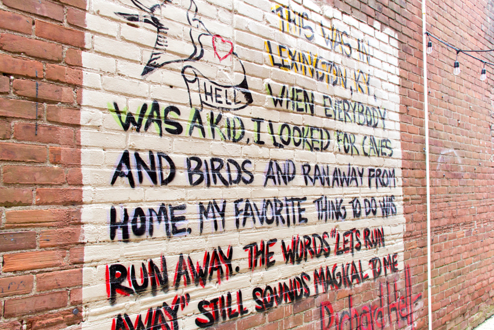 word mural inside an alley off north limestone in lexington