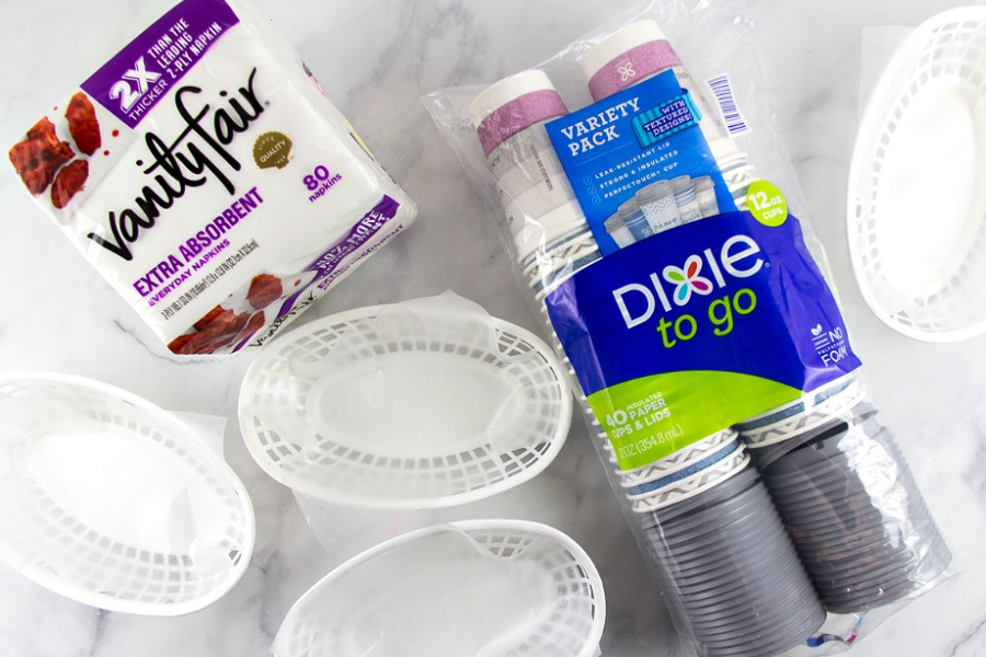 plastic food baskets, to-go cups, and napkins for a football party at home
