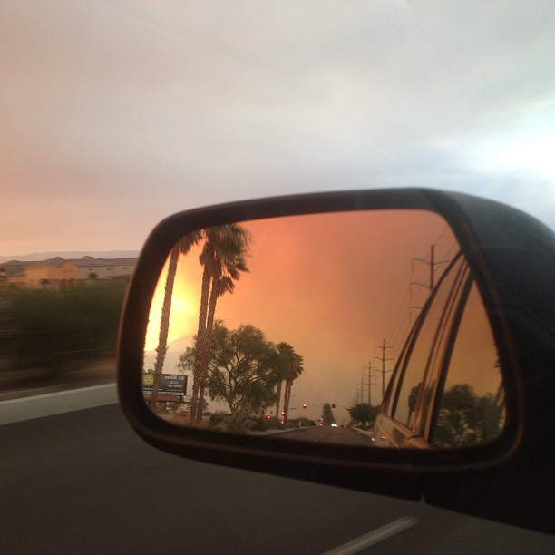 looking in the car mirror at the fires in the San Jacinto Mountains.