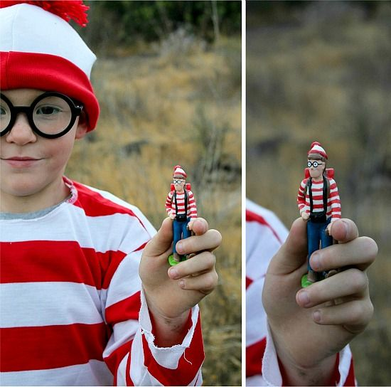 A boy wearing a Where's Waldo costume and holding a Where's Waldo toy for geocaching.