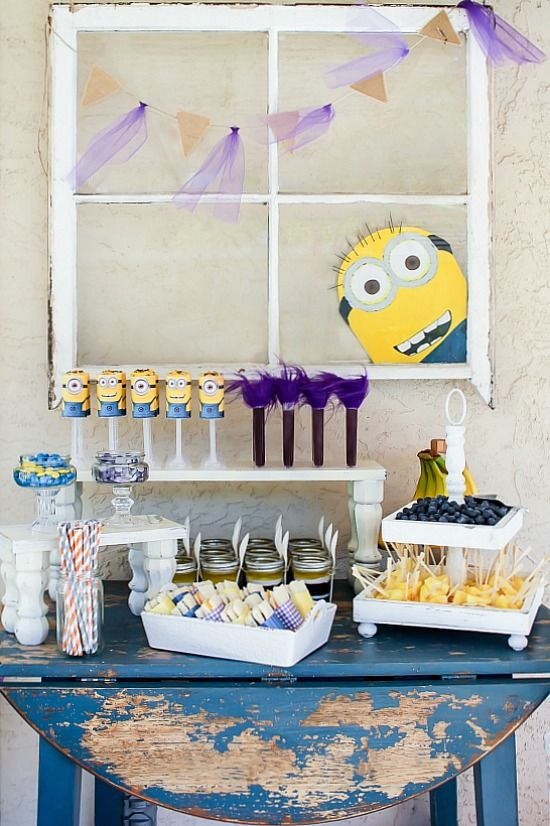 Despicable Me Minion party table with food and drinks