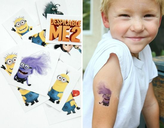 a boy wearing a purple evil minion tattoo on his arm