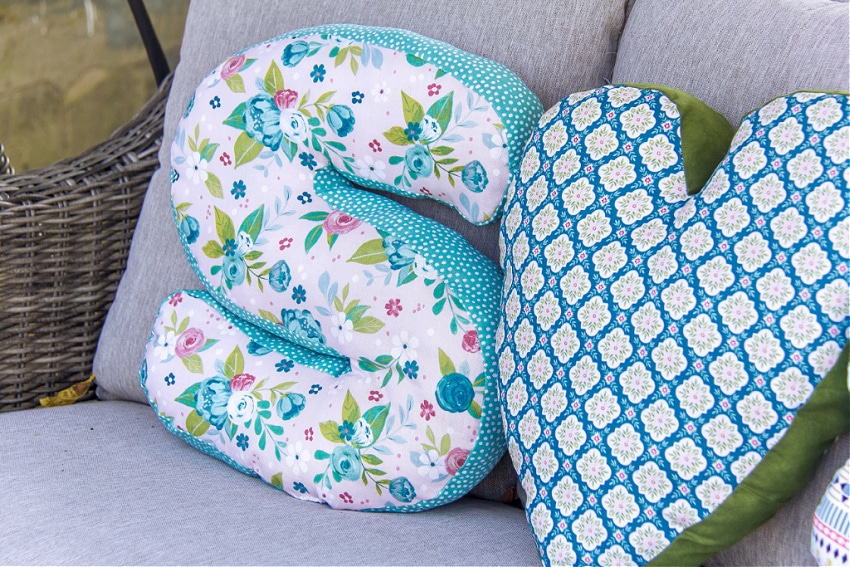 handmade letter and heart-shaped pillows made with floral fabric