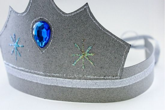 instructions for decorating a paper crown with glitter and gems