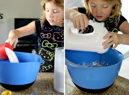 a girl mixing batter for cookies in a large mixing bowl