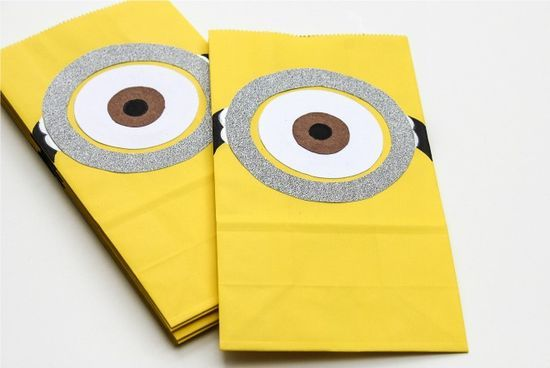 Yellow minion candy bags for a pinata.