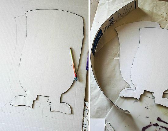 A minion shape cut out of cardboard to make a pinata.