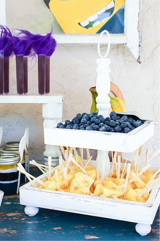 Pineapple, blueberries, and bananas for healthy Minion party treats.