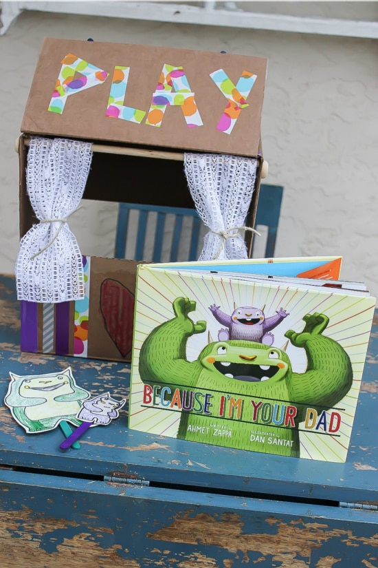 Because I'm Your Dad book and a homemade puppet theater to act out the story.