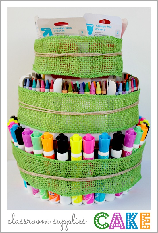 A back-to-school classroom supplies cake with markers and crayons.