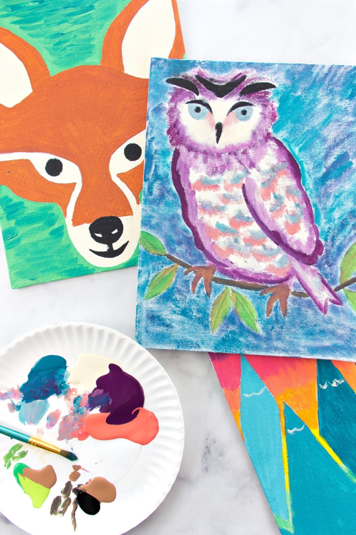 Paintings of a fox, owl, and mountains that used stencils.