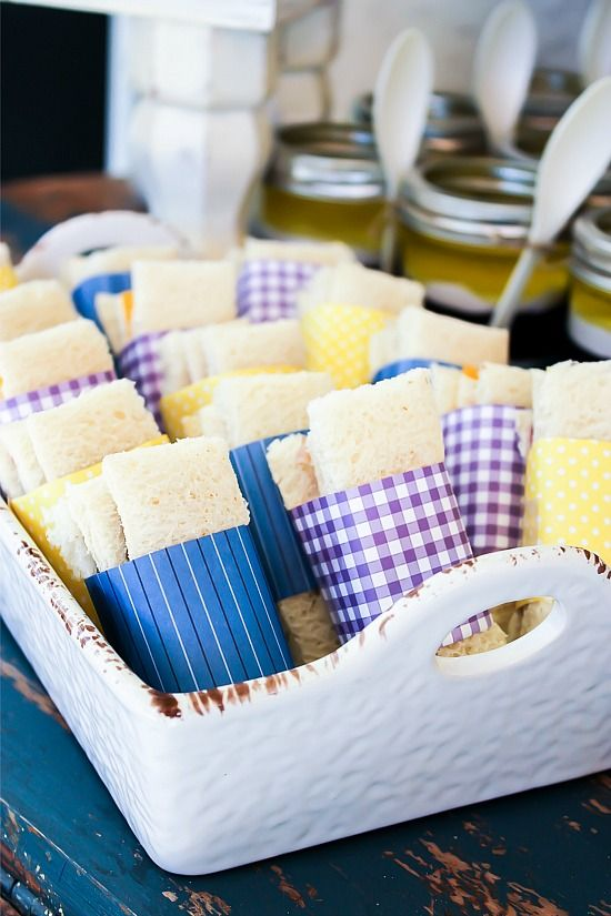 Sandwiches wrapped in paper to match a party color theme.