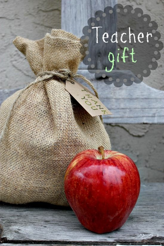 A burlap bag filled with apples with a card attached that reads we got the pick of the bunch.