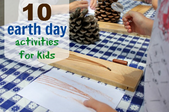 Kids doing earth day rubbings with pine needles.
