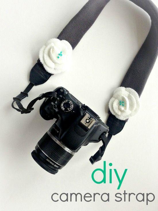 Handmade camera strap cover using fleece and fabric flowers.