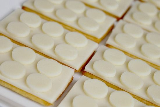 Cheese cut into rectangular slices to put on top of crackers. Small circles of cheese placed on top to make them look like LEGO blocks.