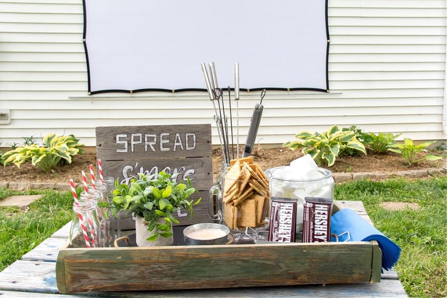 Backyard entertaining ideas including a s'mores bar for an outdoor movie night.