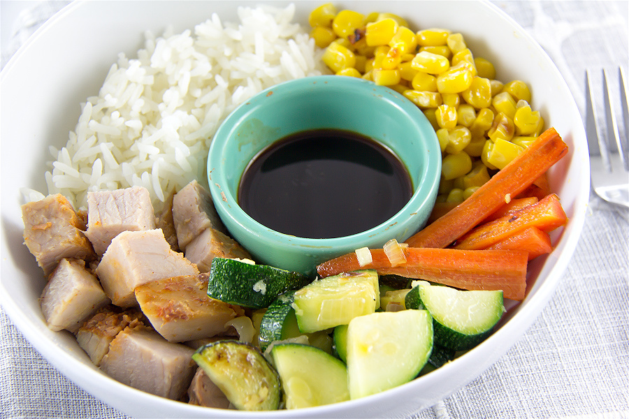 leftover pork loin recipe with rice and vegetables in a bowl