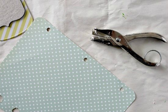 Tips for making a DIY scrapbook album including hole punching pages and binding them.