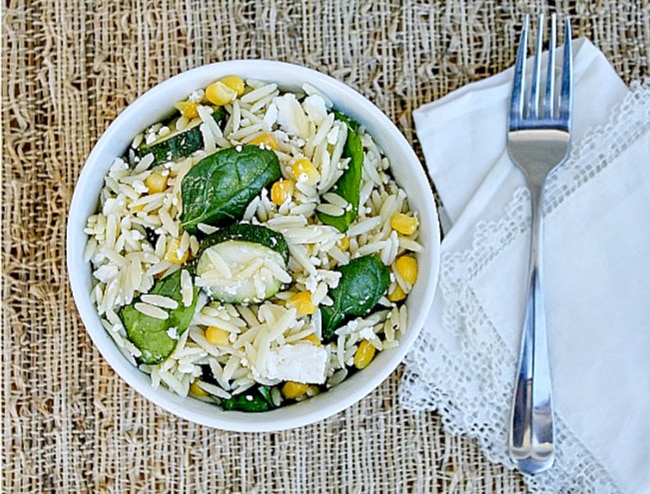Orzo salad with zucchini, spinach, and corn.