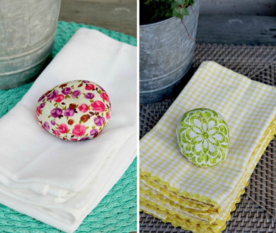 Napkin weights made out of rocks and fabric.