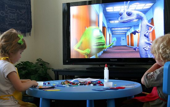 kids doing a craft while watching monsters inc