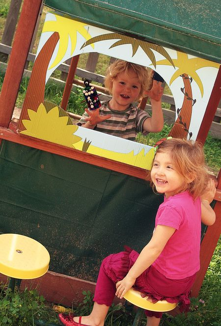kids putting on a monster puppet show