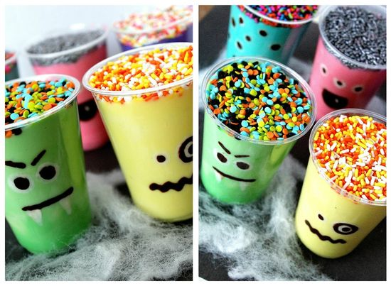 Plastic cups with chocolate monster faces and colorful pudding inside.