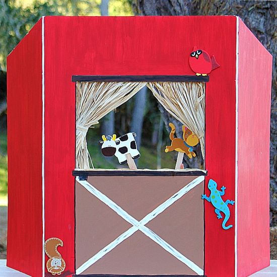 A barnyard puppet theater made out of an Elmer's tri fold board.