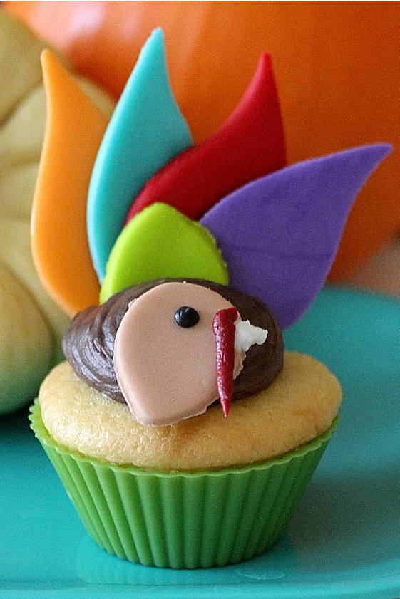 turkey cupcakes with colorful fondant feathers