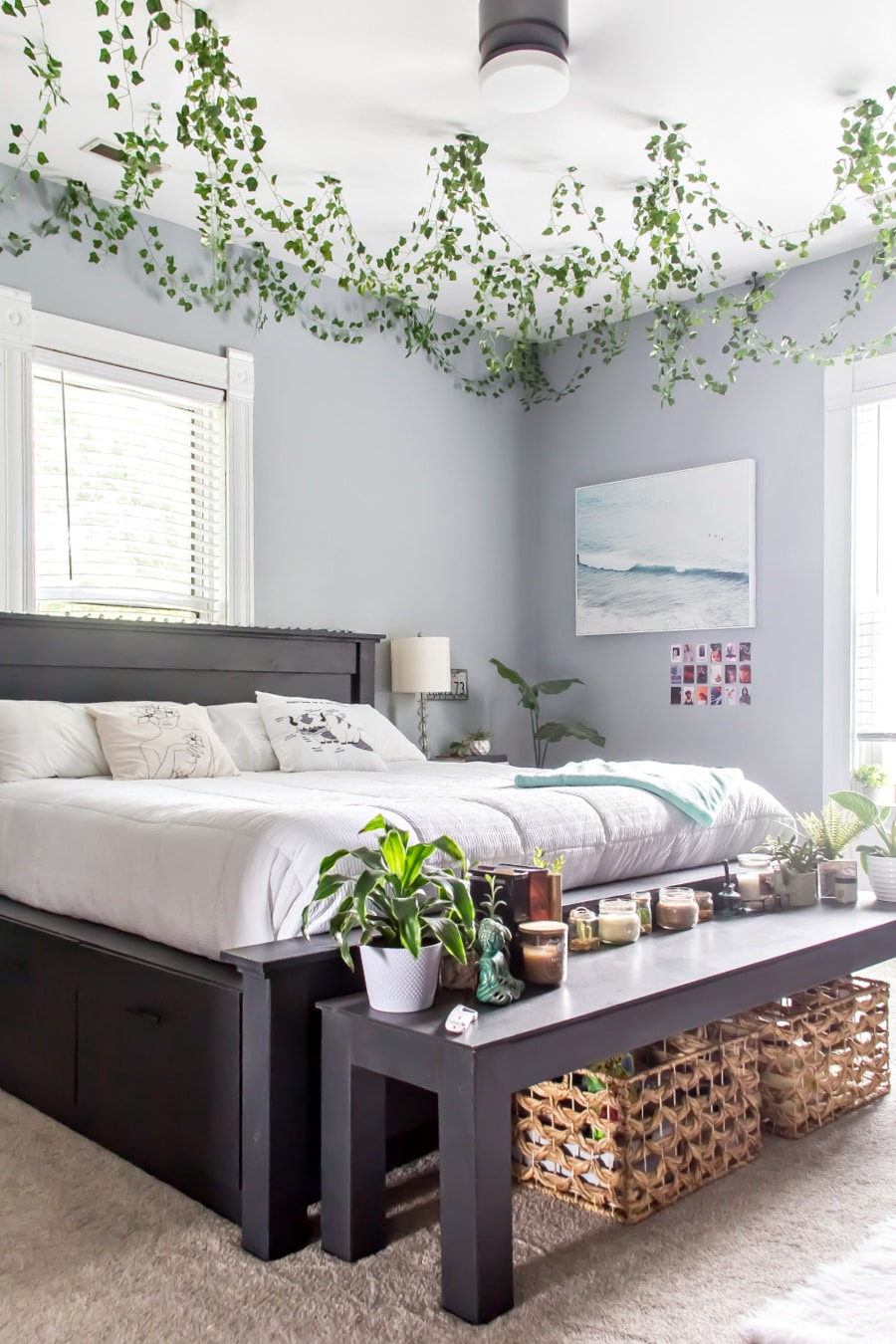 bedroom idea teenage girl with black furniture, grey walls, white decor, plants on the ceiling, and decorations.
