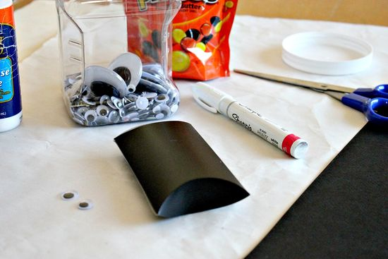 A Halloween bat craft treat box made using toilet paper rolls or pillow boxes.