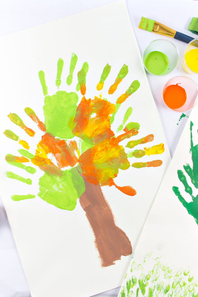 A fall handprint tree art project for kids to make.