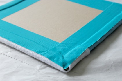 Use tape to attach felt to cardboard to make a felt board.