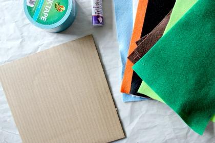 Cardboard, felt, tape, and glue to make a felt board for kids