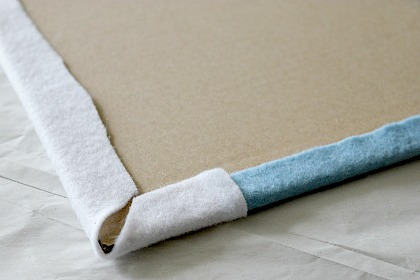 How to attach felt to cardboard to make a felt board.