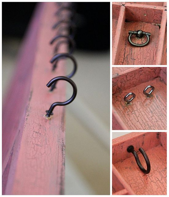 Hooks, eye screws, and decorative rings being added to a wall jewelry organizer