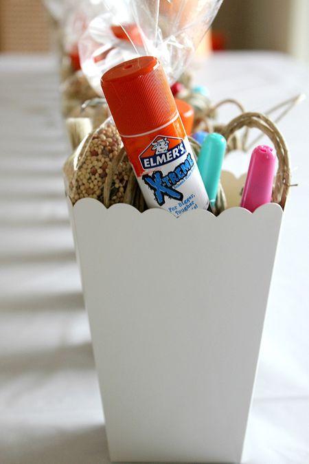 A popsicle stick bird feeder craft kit for kids.