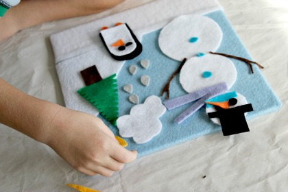 A snowman and penguin winter felt board craft for kids.