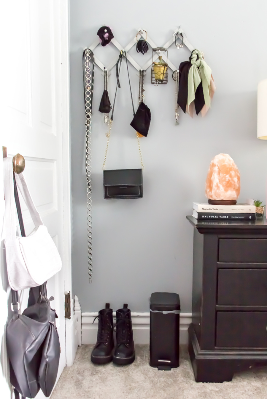 wall jewelry and accessory organizer in a teenage girls bedroom